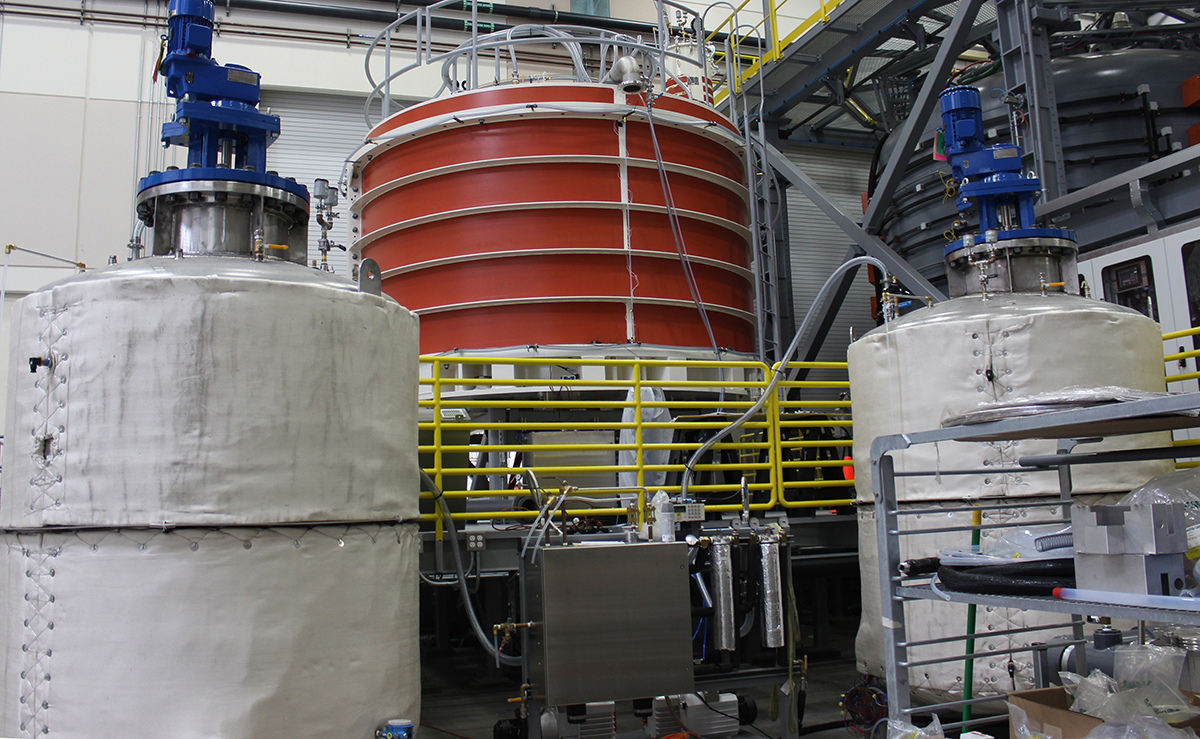 Module mold along side resin tanks, and mixing pump system for  injecting 3,000 liters of resin to encapsulate the module